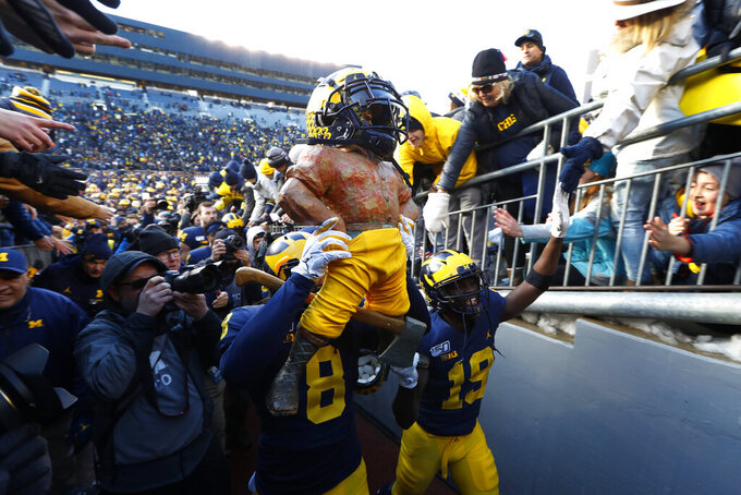 No. 14 Michigan, behind Patterson, rips Michigan State 44-10
