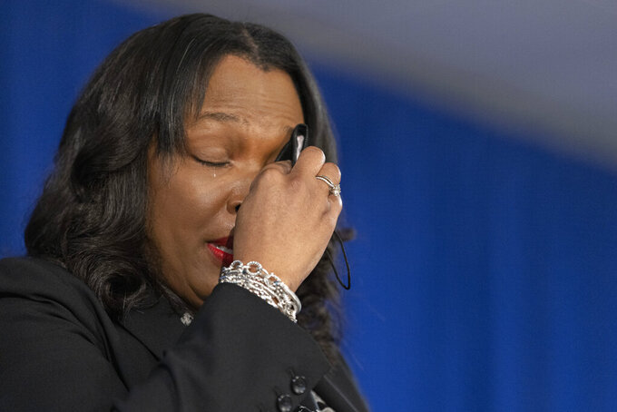 """Chicago Public Schools CEO Janice Jackson wipes away tears as she speaks about her time at CPS during a news conference, Monday, May 3, 2021 in Chicago. The leader of Chicago Public Schools announced that she is leaving the post later this year because it's time to """"pass the torch to new leadership"""" of the nation's third-largest school district. (Anthony Vazquez/Chicago Sun-Times via AP)"""