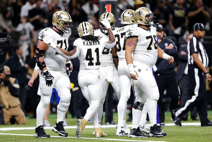 New Orleans Saints running back Alvin Kamara (41) celebrates his touchdown carry in the first half of an NFL wild-card playoff football game against the Minnesota Vikings, Sunday, Jan. 5, 2020, in New Orleans. (AP Photo/Brett Duke)