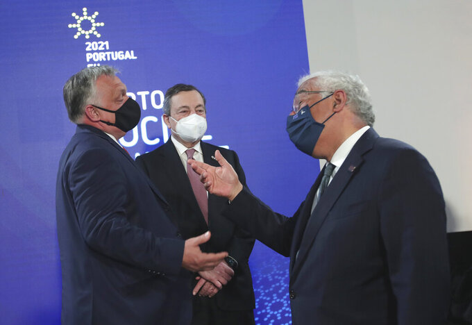 Portugal's Prime Minister Antonio Costa, right, speaks with Hungary's Prime Minister Viktor Orban, left, and Italy's Prime Minister Mario Draghi, center, during the opening ceremony of an EU summit at the Alfandega do Porto Congress Center in Porto, Portugal, Friday, May 7, 2021. European Union leaders are meeting for a summit in Portugal on Friday, sending a signal they see the threat from COVID-19 on their continent as waning amid a quickening vaccine rollout. Their talks hope to repair some of the damage the coronavirus has caused in the bloc, in such areas as welfare and employment. (AP Photo/Luis Vieira, Pool)