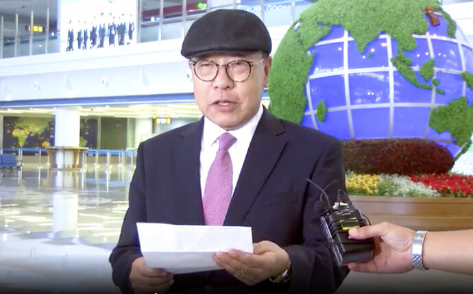 In this image made from video taken on Saturday, July 6, 2019, by North Korean Uriminzokkiri state-run website, shows the son of the highest-profile South Korean ever to defect to North Korea, Choe In-guk giving a statement to media as he arrived in the North to permanently resettle. Choe, the son of a former South Korean foreign minister, said he's over 70 years old and that he decided to live in North Korea for the rest of his life because it was his parents'