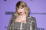 "FILE - Taylor Swift attends the premiere of ""Taylor Swift: Miss Americana"" during the 2020 Sundance Film Festival in Park City, Utah on Jan. 23, 2020. Swift will perform at this month's Grammy Awards. (Photo by Charles Sykes/Invision/AP, File)"