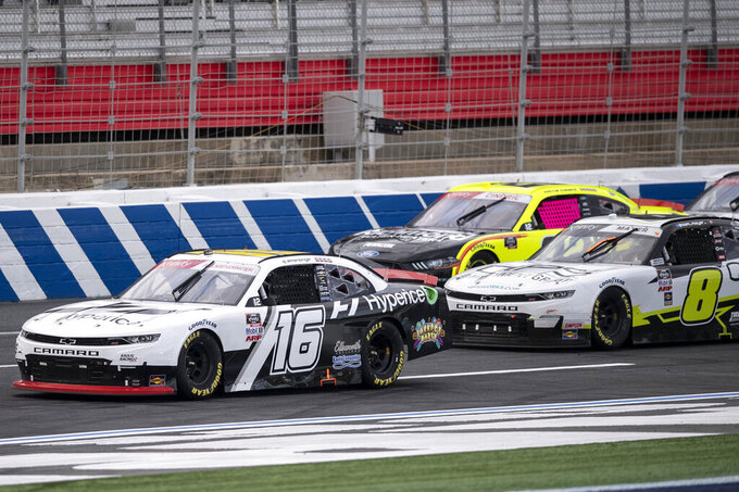 NASCAR Xfinity Series driver AJ Allmendinger (16) leads a pack of cars during the NASCAR Xfinity auto racing race at the Charlotte Motor Speedway Sunday, Oct. 10, 2021, in Concord, N.C. (AP Photo/Matt Kelley)