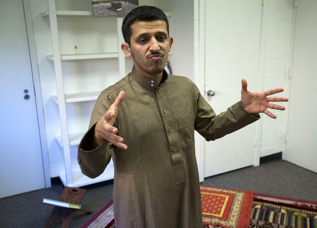 Student Abdulrahman Alshehri speaks to the Associated Press using American Sign Language at Gallaudet University in Washington, Wednesday, Dec. 11, 2019.   Driven by different spiritual traditions, students and faculty alike participate in forms of Christianity, Islam, and Judaism that cater to the non-hearing, complete with worship services and even activism rooted in the dual experiences of being deaf and a person of faith.  (AP Photo/Jose Luis Magana)