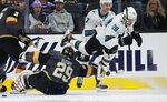 San Jose Sharks right wing Timo Meier (28) falls over Vegas Golden Knights goaltender Marc-Andre Fleury (29) after Meier scored during the second period of an NHL hockey game Thursday, Nov. 21, 2019, in Las Vegas. (AP Photo/John Locher)