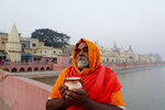 A Sadhu, Hindu holy man, offers prayers in Ayodhya, India , Saturday, Nov. 9, 2019. India's security forces were on high alert ahead of the Supreme Court's verdict Saturday in a decades-old land title dispute between Muslims and Hindus over plans to build a Hindu temple on a site where Hindu hard-liners demolished a 16th century mosque in 1992, sparking deadly religious riots. (AP Photo/Rajesh Kumar Singh)