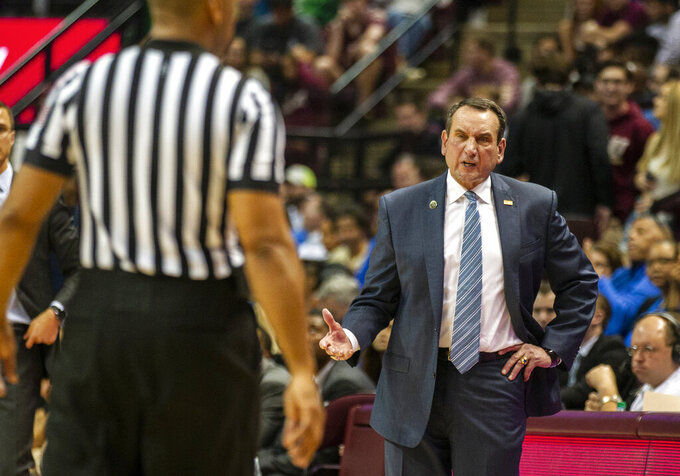 Duke head coach Mike Krzyzewski talks with a referee in the second half of an NCAA college basketball game against Florida State in Tallahassee, Fla., Saturday, Jan. 12, 2019. Duke defeated Florida State 80-78. (AP Photo/Mark Wallheiser)