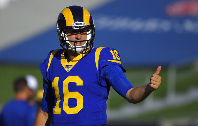 FILE - In this Aug. 24, 2019, file photo, Los Angeles Rams quarterback Jared Goff (16) warms up before the start of an NFL preseason football game against the Denver Broncos, in Los Angeles.  Todd Gurley, Aaron Donald and now Jared Goff have all agreed to contract extensions over the past year that set new NFL benchmarks for guaranteed money at their respective positions. (AP Photo/Mark J. Terrill, File)
