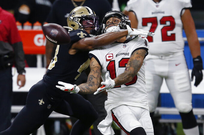 New Orleans Saints free safety Marcus Williams (43) commits pass interference as Tampa Bay Buccaneers wide receiver Mike Evans (13) tries to catch a pass in the second half of an NFL football game in New Orleans, Sunday, Sept. 13, 2020. (AP Photo/Butch Dill)