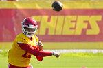Kansas City Chiefs quarterback Patrick Mahomes passes the ball at NFL football training camp Tuesday, Aug. 17, 2021, in St. Joseph, Mo. (AP Photo/Charlie Riedel)