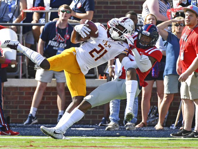 FILE - In this Oct. 6, 2018, file photo, Louisiana Monroe cornerback Corey Straughter (21) breaks up a pass intended for Mississippi wide receiver DaMarkus Lodge (5) during the first half of an NCAA college football game, in Oxford, Miss. Louisiana-Monroe plays at No. 24 Appalachian State on Saturday, Oct. 19, 2019. (AP Photo/Thomas Graning, FIle)