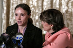 Teala Davies, left, speaks as her attorney Gloria Allred, right, listens during a news conference, Thursday, Nov. 21, 2019, in New York, about the filing of a lawsuit against the estate of Jeffrey Epstein. Davies says she was 17 when she was victimized by Epstein. (AP Photo/Jeenah Moon)