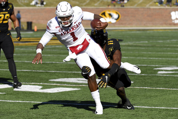 Arkansas quarterback KJ Jefferson (1) runs with the ball as Missouri linebacker Devin Nicholson (11) defends during the first half of an NCAA college football game Saturday, Dec. 5, 2020, in Columbia, Mo. (AP Photo/L.G. Patterson)