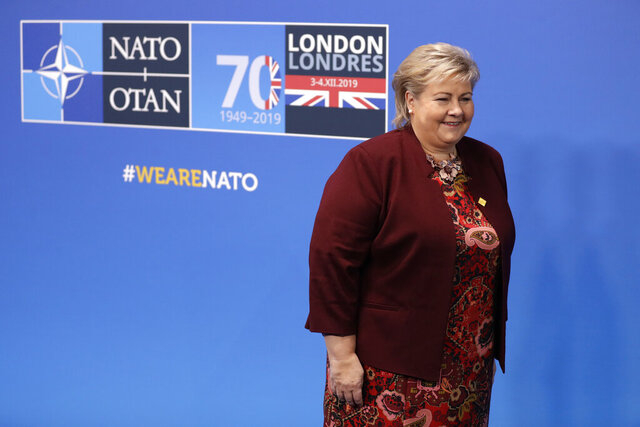 Norway's Prime Minister Erna Solberg arrives for a NATO leaders meeting at The Grove hotel and resort in Watford, Hertfordshire, England, Wednesday, Dec. 4, 2019. As NATO leaders meet and show that the world's biggest security alliance is adapting to modern threats, NATO Secretary-General Jens Stoltenberg is refusing to concede that the future of the 29-member alliance is under a cloud. (AP Photo/Matt Dunham)