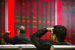 In this Oct. 31, 2018, photo, Chinese investors monitor stock prices at a brokerage house in Beijing. China's government is trying to dispel stock market gloom and talk prices back up with promises of tax cuts and a media campaign led by its economic czar. (AP Photo/Mark Schiefelbein)