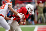 Nebraska quarterback Adrian Martinez (2) runs into the end zone for a touchdown past Illinois defensive back SydneyBrown (30) during the first half of an NCAA college football game in Lincoln, Neb., Saturday, Nov. 10, 2018. (AP Photo/Nati Harnik)