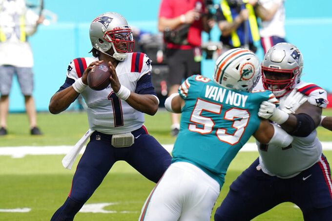 New England Patriots quarterback Cam Newton (1) aims a pass during the first half of an NFL football game against the Miami Dolphins, Sunday, Dec. 20, 2020, in Miami Gardens, Fla. (AP Photo/Chris O'Meara)
