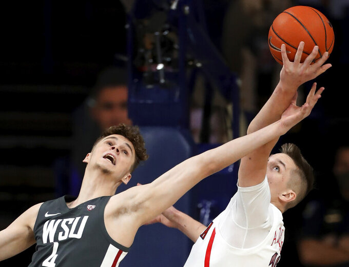 Washington State forward Aljaz Kunc (4) just misses coming down with a rebound, next to Arizona forward Azuolas Tubelis (10) during the first half of an NCAA college basketball game Thursday, Feb. 25, 2021, in Tucson, Ariz. (Kelly Presnell/Arizona Daily Star via AP)