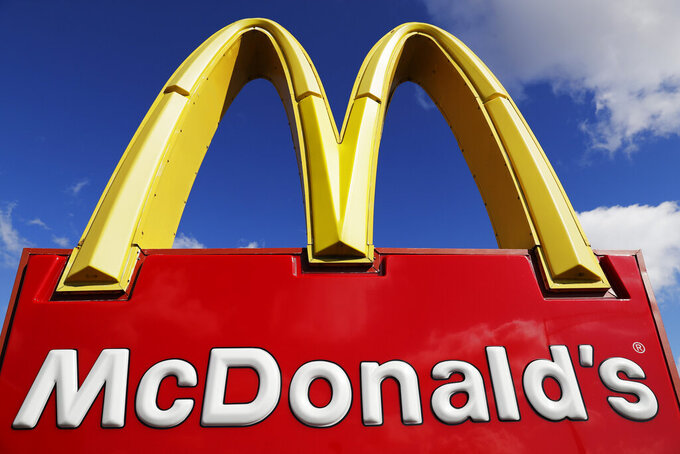 FILE - This April 9, 2020 file photo shows a McDonald's sign in Wheeling, Ill. McDonald's ended 2020 on a strong note, recovering nearly all of the global sales lost in the pandemic despite a resurgent virus. (AP Photo/Nam Y. Huh, File)