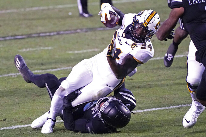 Missouri running back Larry Rountree III (34) is tackled by a Mississippi State defender after a short gain during the second half of an NCAA college football game, Saturday, Dec. 19, 2019, in Starkville, Miss. (AP Photo/Rogelio V. Solis)