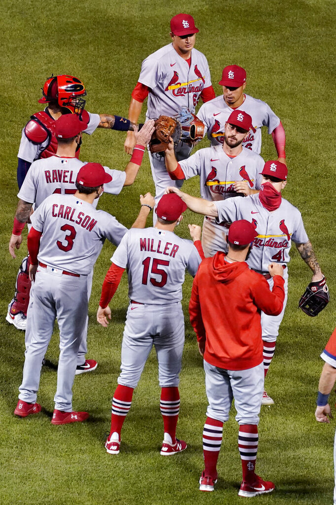 St. Louis Cardinals players celebrate after the Cardinals defeated the Chicago Cubs 7-3 in a baseball game in Chicago, Sunday, Sept. 6, 2020. (AP Photo/Nam Y. Huh)