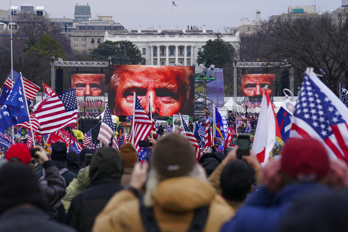 FILE - In this Jan. 6, 2021 file photo, Trump supporters participate in a rally in Washington.  An AP review of records finds that members of President Donald Trump's failed campaign were key players in the Washington rally that spawned a deadly assault on the U.S. Capitol last week. (AP Photo/John Minchillo)