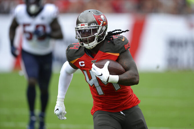 FILE - Tampa Bay Buccaneers running back Dare Ogunbowale (44) runs after a catch against the Houston Texans during the first half of an NFL football game Saturday, Dec. 21, 2019, in Tampa, Fla. The Jacksonville Jaguars placed running back Devine Ozigbo on injured reserve with a left hamstring injury Thursday, Sept. 10, 2020, and signed former Tampa Bay running back Dare Ogunbowale to fill his roster spot. Ogunbowale could be in uniform for the team's opener Sunday against Indianapolis since Jacksonville has little depth at the position. (AP Photo/Jason Behnken, File)