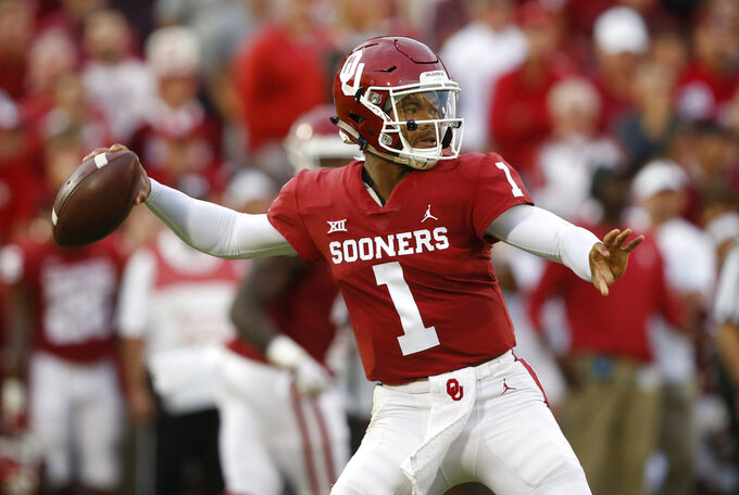 FILE - In this Saturday, Sept. 22, 2018 file photo, Oklahoma quarterback Kyler Murray (1) throws in the first half of an NCAA college football game against Army in Norman, Okla. No. 6 Oklahoma and No. 12 West Virginia meet in a regular season finale with the winner headed to the Big 12 championship game. The loser could also make it to the December 1 title game, but would need help. The Sooners and Mountaineers play Friday night, Nov. 23, 2018, after Texas plays at Kansas earlier in the day. The Longhorns clinch a spot in the Big 12 title game if they beat the Jayhawks. (AP Photo/Sue Ogrocki, File)