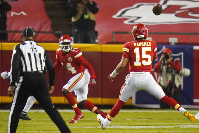 Kansas City Chiefs quarterback Patrick Mahomes (15) throws a touchdown pass to wide receiver Sammy Watkins (14) in the first half of an NFL football game against the Houston Texans Thursday, Sept. 10, 2020, in Kansas City, Mo. (AP Photo/Jeff Roberson)