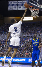 Nevada guard Corey Henson (2) shoots a layup as San Jose State' Christian Anigwe watches during the first half of an NCAA college basketball game in Reno, Nev., Wednesday, Jan. 9, 2019. (AP Photo/Tom R. Smedes)