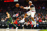Atlanta Hawks forward Vince Carter passes the ball after saving it from going out of bounds during the first half of an NBA basketball game against the Utah Jazz, Thursday, March 21, 2019, in Atlanta. (AP Photo/John Amis)