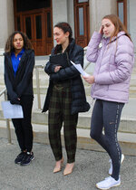 FILE - In this Feb. 12, 2020 file photo, high school track athletes Alanna Smith, left, Selina Soule, center, and Chelsea Mitchell prepare to speak at a news conference outside the Connecticut State Capitol in Hartford, Conn. The U.S. Department of Education is threatening to withhold some federal funding for Connecticut school districts if they follow a state policy that allows transgender girls to compete as girls in high school sports. In response to a complaint filed last year by several cisgender female track athletes who argued that two transgender female runners had an unfair physical advantage, the federal agency's office for civil rights determined in May that Connecticut's policy violates the civil rights of athletes who are not transgender. (AP Photo/Pat Eaton-Robb, File)