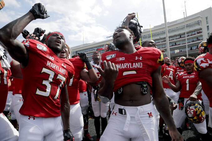 Maryland defensive back Lavonte Gater, left, and running back Tayon Fleet-Davis dance with teammates after they defeated Howard 79-0 in an NCAA college football game, Saturday, Aug. 31, 2019, in College Park, Md. (AP Photo/Julio Cortez)