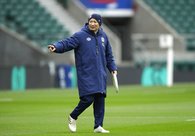 England coach Eddie Jones gestures holding a frisbee during an England rugby team training session at Twickenham in London, Saturday, Oct.17, 2020. England are preparing for a series of matches including the finish of the Six Nations championship which was interrupted earlier in the year because of the coronavirus outbreak. (AP Photo/Matt Dunham, Pool)