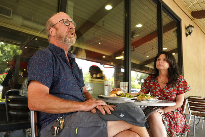 Curtis Selland and Leslie Pugsley, both Democrats shared their views on the September recall of Gov. Gavin Newsom, over lunch in Fresno, Calif., Thursday, July, 29, 2021.Both said they would vote against the recall but aren't his biggest fans. (AP Photo/Rich Pedroncelli)