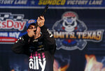 Jimmie Johnson (48) aims a rifle in victory lane after taking the pole position for the NASCAR Cup Series auto race at Texas Motor Speedway in Fort Worth, Texas, Friday, March 29, 2019. (AP Photo/LM Otero)
