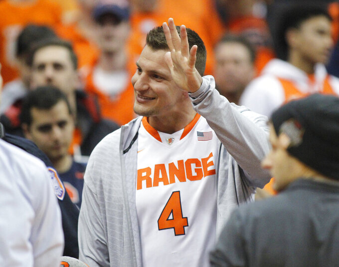 New England Patriots football player Rob Gronkowski waves to fans before Syracuse's NCAA college basketball game against Duke in Syracuse, N.Y., Saturday, Feb. 23, 2019. (AP Photo/Nick Lisi)