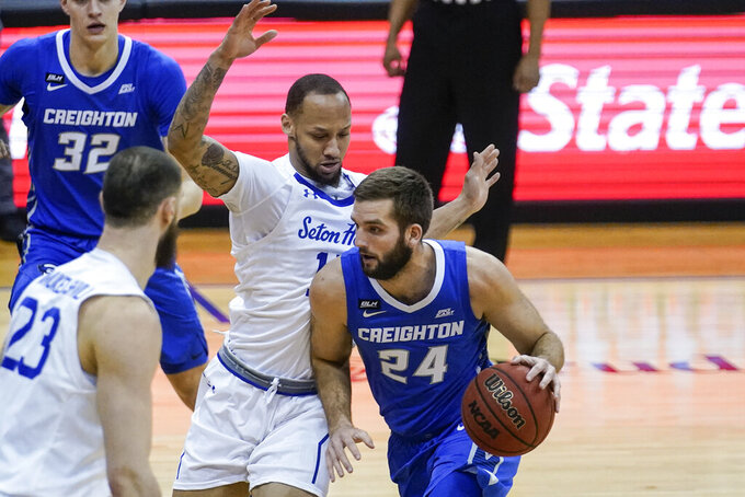 Creighton's Mitch Ballock (24) drives past Seton Hall's Takal Molson (15) during the first half of an NCAA college basketball game Wednesday, Jan. 27, 2021, in Newark, N.J. (AP Photo/Frank Franklin II)