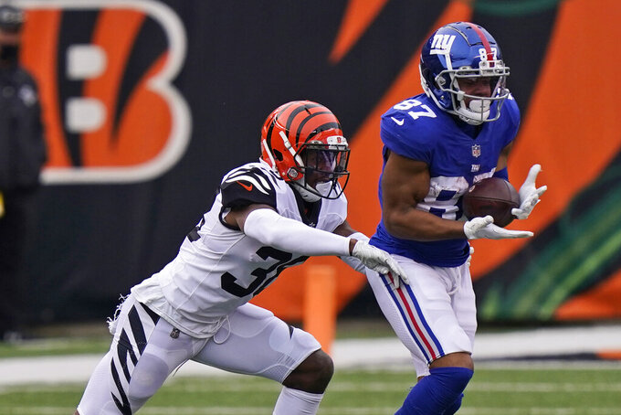 New York Giants wide receiver Sterling Shepard (87) catches a pass during the second half of NFL football game against the Cincinnati Bengals, Sunday, Nov. 29, 2020, in Cincinnati. (AP Photo/Bryan Woolston)