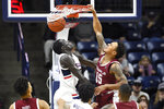 Temple's Nate Pierre-Louis, right, dunks over Connecticut's Akok Akok in the first half of an NCAA college basketball game, Wednesday, Jan. 29, 2020, in Storrs, Conn. (AP Photo/Jessica Hill)