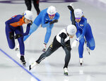 Gold medalist Nana Takagi of Japan, center, silver medalist Kim Bo-reum of South Korea, right, bronze medalist Irene Schouten of The Netherlands, and fourth place Francesca Lollobrigida of Italy sprint towards the finish line of the women's mass start final speedskating race at the Gangneung Oval at the 2018 Winter Olympics in Gangneung, South Korea, Saturday, Feb. 24, 2018. (AP Photo/Petr David Josek)
