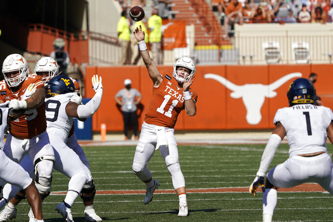 Texas' Sam Ehlinger (11) throws a pass against West Virginia during the second half of an NCAA college football game in Austin, Texas, Saturday, Nov. 7, 2020. (AP Photo/Chuck Burton)