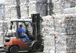 In this June 18, 2019, photo, a plastic recycling company worker on a forklift truck moves a pile of plastic bottles collected for processing at Tokyo Petbottle Recycle Co., Ltd, in Tokyo. Japan has a plastic problem. Single bananas here are sometimes wrapped in plastic. So are individual pieces of vegetables, fruit, pastries, pens and cosmetics. Plastic-wrapped plastic spoons come with every ice cream cup. But as world leaders descend on Osaka for the two-day G20 Summit that starts Friday, June 28, Japan has ambitions to become a world leader in reducing plastic waste. (AP Photo/Koji Sasahara)