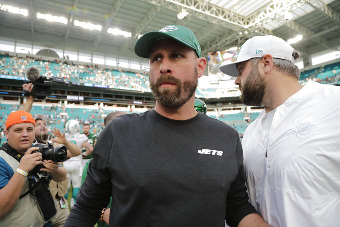 New York Jets head coach Adam Gase walks off the field after an NFL football game against the Miami Dolphins, Sunday, Nov. 3, 2019, in Miami Gardens, Fla. (AP Photo/Lynne Sladky)