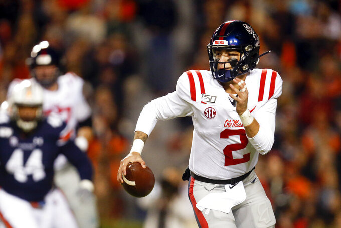Mississippi quarterback Matt Corral scrambles for yardage during the first half of the team's NCAA college football game against Auburn, Saturday, Nov. 2, 2019, in Auburn, Ala. (AP Photo/Butch Dill)