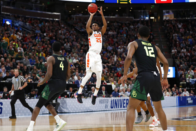Syracuse guard Tyus Battle (25) shoots against Baylor guard Mario Kegler (4) and guard Jared Butler (12) during the second half of a first-round game in the NCAA men's college basketball tournament Thursday, March 21, 2019, in Salt Lake City. (AP Photo/Jeff Swinger)