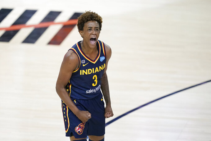 Indiana Fever's Danielle Robinson celebrates after the Fever defeated the Connecticut Sun in a WNBA basketball game, Saturday, July 3, 2021, in Indianapolis. (AP Photo/Darron Cummings)