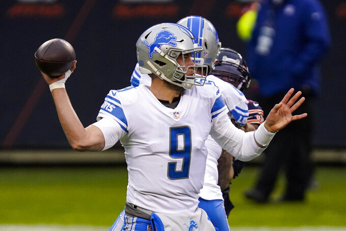 Detroit Lions quarterback Matthew Stafford (9) throws against the Chicago Bears in the first half of an NFL football game in Chicago, Sunday, Dec. 6, 2020. (AP Photo/Charles Rex Arbogast)