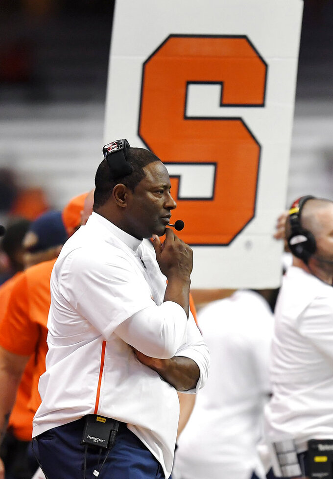 Syracuse head coach Dino Babers watches from the sideline during the second half of an NCAA college football game against Louisville in Syracuse, N.Y., Friday, Nov. 9, 2018. (AP Photo/Adrian Kraus)