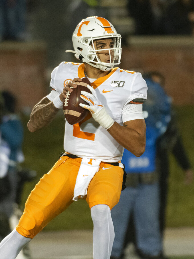 Tennessee quarterback Jarrett Guarantano sets to throw a pass during the first quarter of an NCAA college football game against Missouri, Saturday, Nov. 23, 2019, in Columbia, Mo. (AP Photo/L.G. Patterson)
